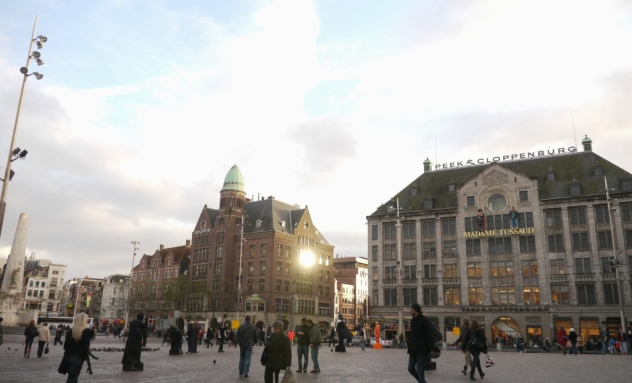 sunset (with a beautiful reflection) at the dam square...